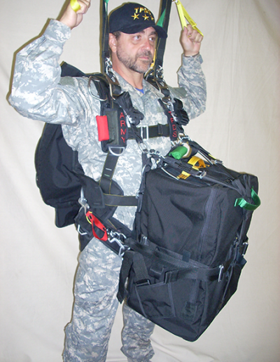 Man posing with Heavy Load Tactical parachute gear
