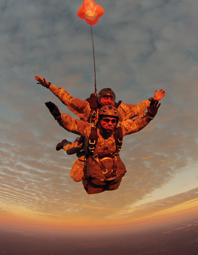 Heavy Load Tactical tandem skydive with drouge at sunset