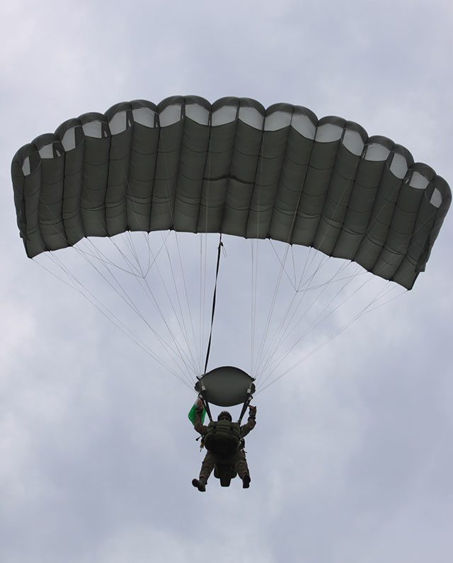 Looking up at a tactical parachuter