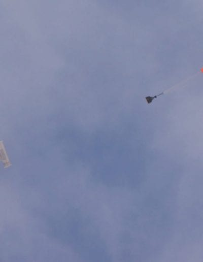 Airplane dropping G11 cargo parachute and cargo