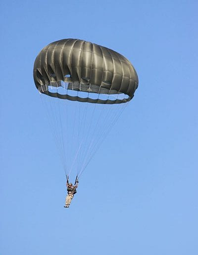Man descending in an Invasion II Steerable parachute