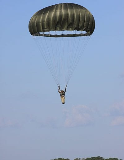Man preparing to land in an Invasion II Steerable parachute