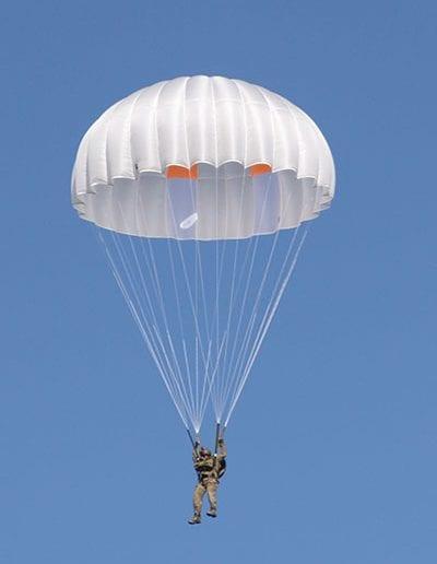 Man descending in a reserve parachute