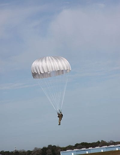 Man coming in for a landing in a reserve parachute