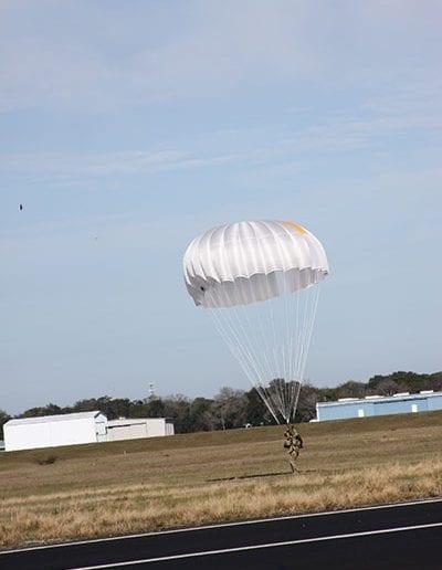 Man landing in a reserve parachute