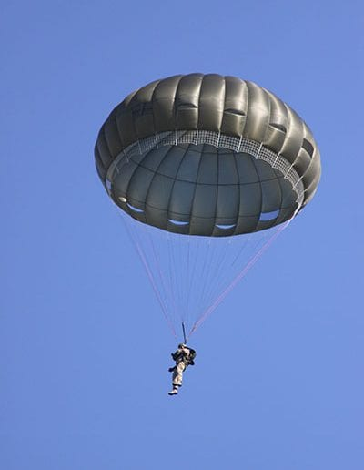 Man descending with Invasion II Non-Steerable parachute