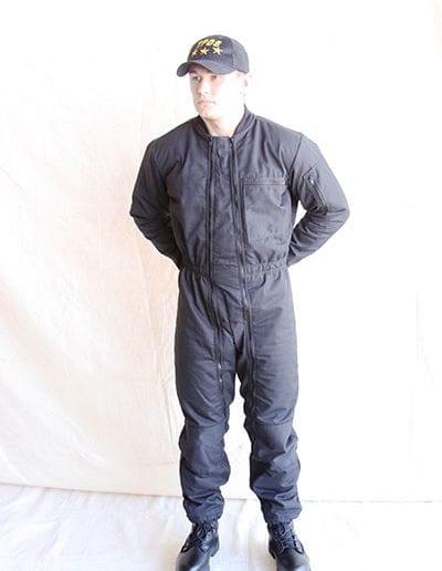 Man posing in black jumpsuit wearing a TPDS cap