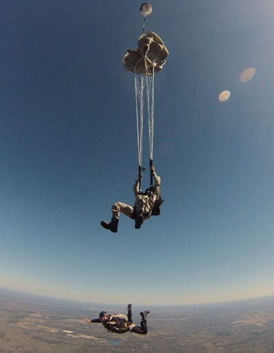 Light Load Tactical chute deploying while instructor continues freefall