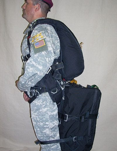 Man posing with Light Load Tactical in low rear position