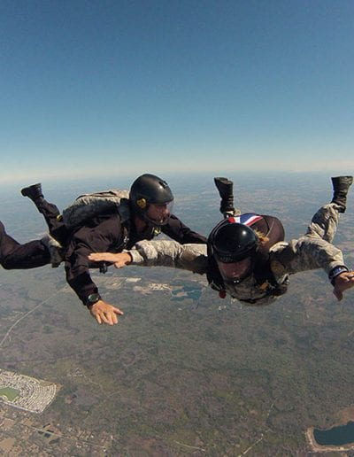 Instructor assisting student in freefall