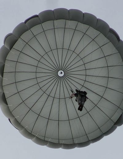 Looking directly up at a descending Invasion II Non-Steerable parachute